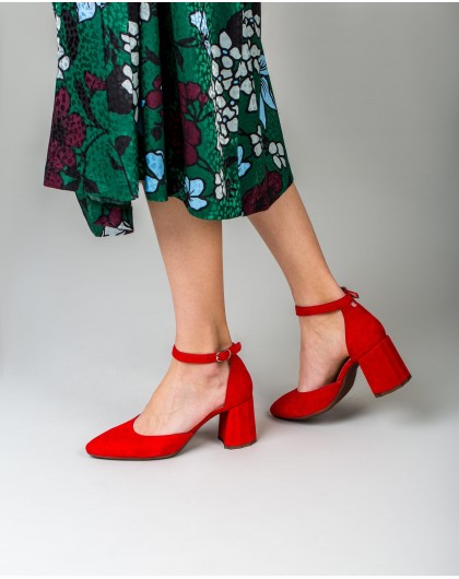 Backless high heeled shoe