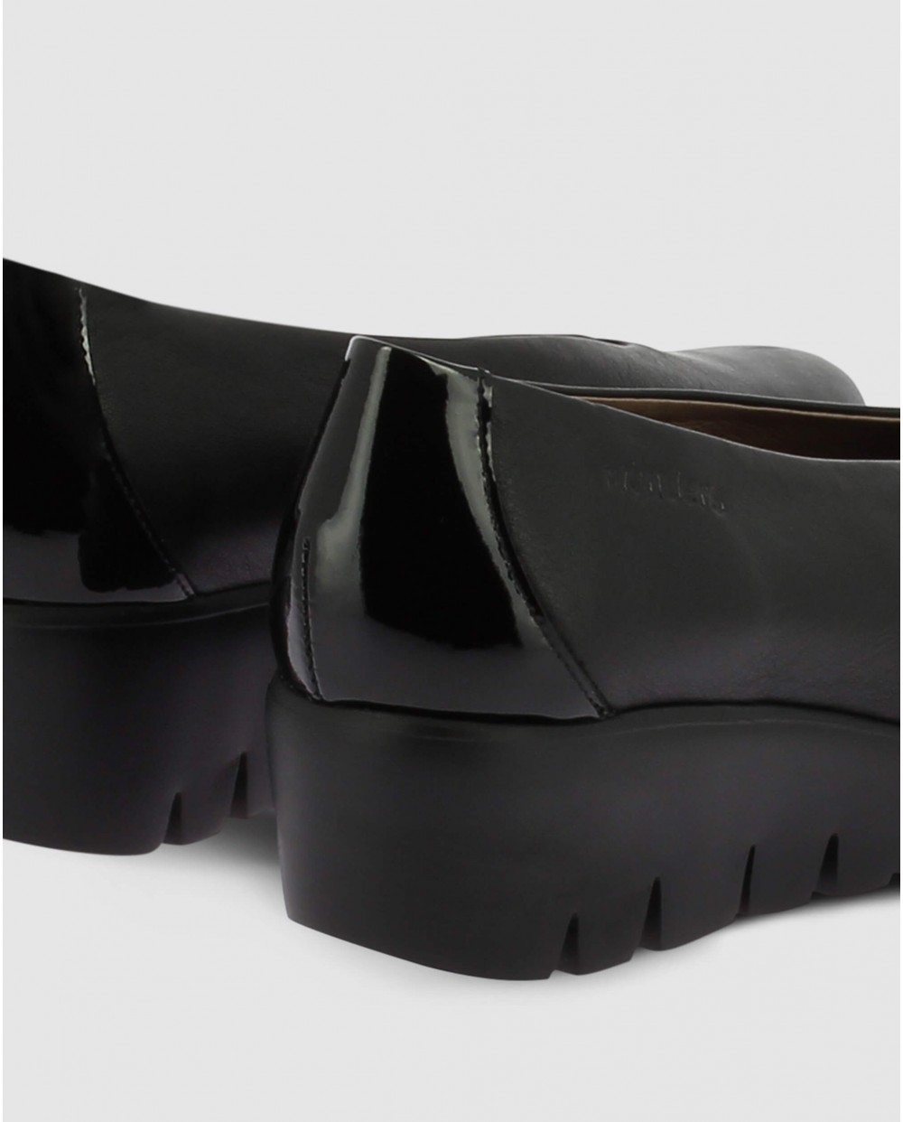 Leather moccasin with wedge heel