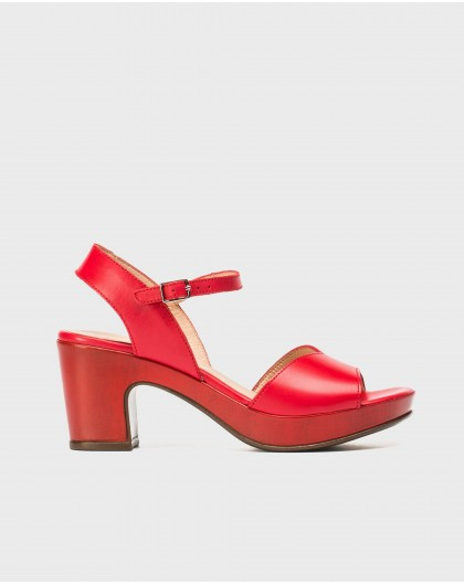 Platform sandal with irregular strap