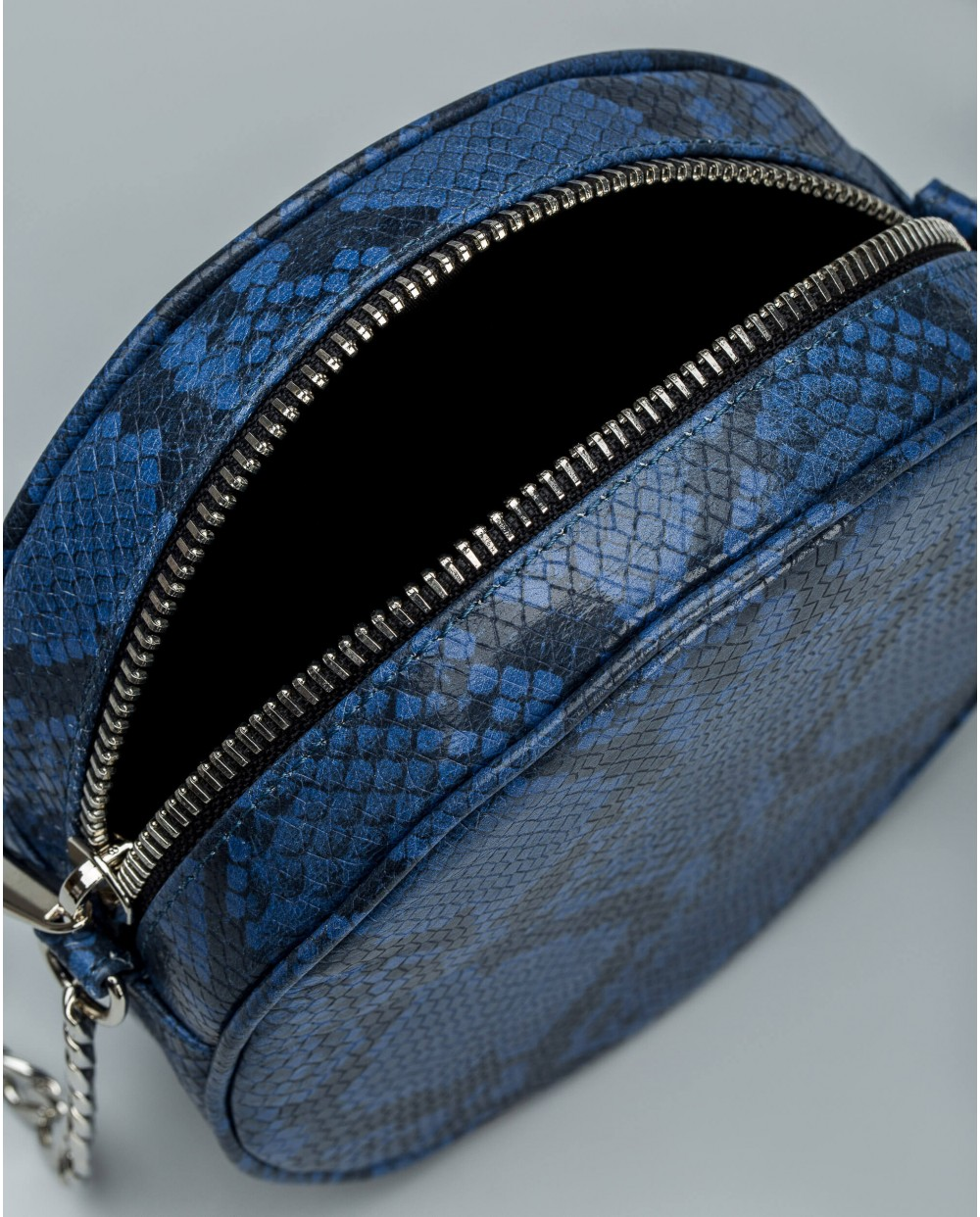 Circular handbag with crossbody strap