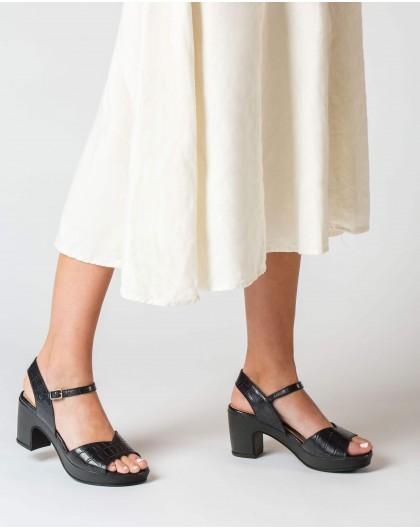 Platform sandal with irregular strap